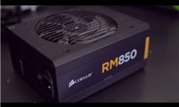 slide {0} of {1},zoom in, Linus demonstrates the new Corsair RM Series 80 PLUS Gold fully modular power supplies