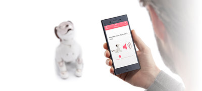 "Stay connected with your aibo using the ""My aibo"" app<sup>1,2.</sup>"